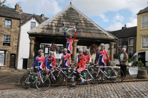 Passing cyclists at the Market Cross – Photography by Simon Danby