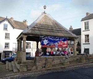 Christmas Carols being sung at the Market Cross